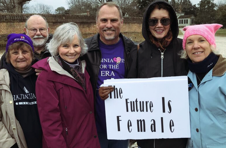 Stan holding a The Future Is Female sign